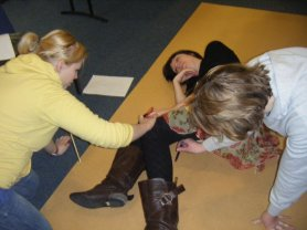 Behind the scenes - Pirates of Penzance - Esme poses as the other girls get to work on the statues at get in