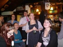 Elena is serenaded in the pub